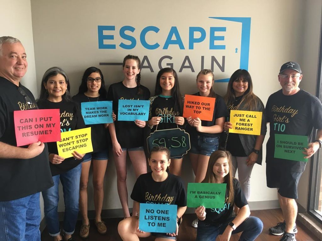 Group of people after their escape room experience at Escape Again Rooms